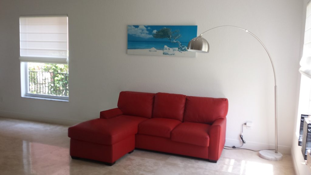 Before Photo with Red Sofa in Living Room